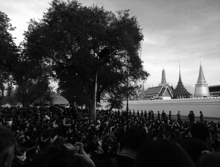 Photographers, spectators and mourners at the Grand Palace